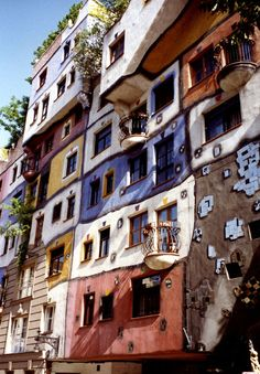 Hundertwasser House Vienna. Astrogeographical position: 2 female signs: the water sign Cancer indicator of the roundshaped forms and of the reflex to want to feel at home at the places where we live and work.  2nd coordinate in Libra wich stands for the reflex to beautify the environment for radius/field level 4 which can be used to describe the building itself here.