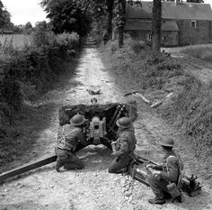 The 6 pdr anti-tank was a good, low profile, 57mm gun which remained in service until the 1950s. As well as being the primary AT weapon in the mid-war period, it was adopted by the US as the 57mm anti-tank gun. This photo is interesting, as it shows very poor tactical consideration in the siting of this weapon. Whether for roadblock or ambush, the anti tank gun should be concealed and placed behind partial hard cover whenever possible.