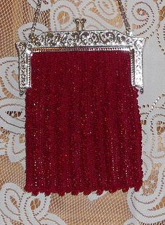 Red beaded knitted purse.