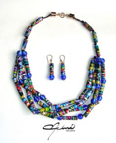 Set of necklace and earrings of polymer clay in the shape of little tubes  made with the Stroppel Cane technique, mounted with knotted waxed linen with murano beads in matching blue color