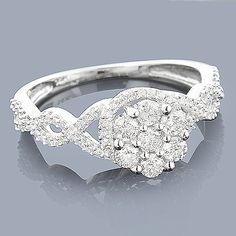 This 14K Cluster Flower Diamond Ring showcases 0.56 carats of genuine diamonds. Featuring a lovely cluster design and a highly polished gold finish, this ladies diamond ring makes an affordable pre-set diamond engagement ring or promise ring, and is available in 14K white, yellow and rose gold.