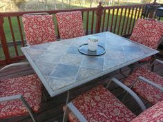 Replacing The Broken Glass on Our Patio Table with a linoleum remnant & plywood - http://fieldsofhether.blogspot.com/2015/05/replacing-broken-glass-on-our-patio.html