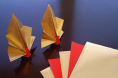 Origami Peacock. Gold and Red. Double sided foil paper.