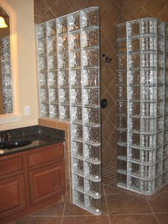 Glass Block shower. L O V E !!! I would do a straight brick wall, from wall to wall with an opening http://www.anchoo.com/wp-content/uploads/2014/04/bathroom-bathroom-ideas-room-decor-glass-block-wall-decorating-cabinet-wall-marble-contemporary-small-bathrooms-designs-pictures-image-decoration-home-interior-shower-renovation-rooms-master-planner-tile-powde-charming-s.jpg http://www.houzz.com/photos/1515597/Glass-block-shower-contemporary-bathroom-cleveland