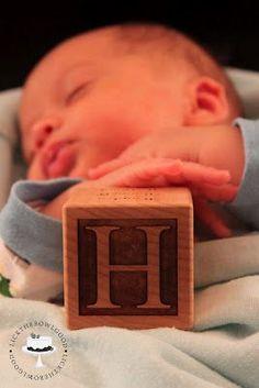 Newborn pose with letter block