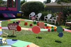 backyard game board! i like the idea of having stations for each zone: Candy Cane Forest and Gum Drop Mountain and have a fun activity for the kids at each. then the board ends at a jump castle : )