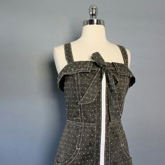 """Gray Polka Dot Dress A darling Charlotte Ronson summer dress that's perfect for everyday wear! Gray with white polka dots, zipper up the front & bow tied around chest. PLUS this dress has pockets (dresses with pockets are the best)! Has only been worn on a a few occasions & is in excellent condition.  Measurements (when laid flat): Bust: 17.5"""" Waist: 15"""" Length: 35.5"""" Charlotte Ronson Dresses Mini"""