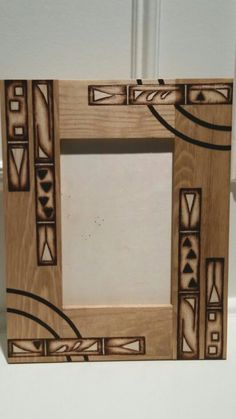 Wood burning (pyrography) by Alicia Schlitz. Picture frame. Burned areas were masked off before applying stain for the best contrast