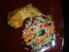 (Healthy Alternative to BarBQ Chicken) Skinless Baked chicken made with seasoned with garlic, parsley, pepper, sea salt, Orange and/or Lemon juice, molasses, and honey plus sauteed (in coconut oil) garlic, spinach, kale, tomatoes, onion, carrots, parsley, yellow and red bell pepper w/ rice