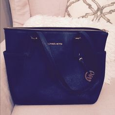 Michael kors navy saffiano leather handbag! Got this as a gift, don't want it anymore. Great condition! I barely used it. Michael Kors Bags