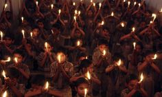 Schoolchildren hold candles during a vigil held in memory of the victims of Wednesday's shootings in Mumbai, in the western Indian city of Ahmedabad November 27, 2008. Elite Indian commandos fought room to room battles with Islamist militants inside two luxury hotels to save scores of people trapped or taken hostage, as the country's prime minister blamed neighbouring countries. (REUTERS/Amit Dave) #