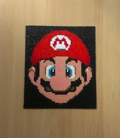 Display your love of Nintendos most recognizable character Mario! Size 13 cm x 15 cm It is available Melty Bead Patterns, Beading Patterns, Super Mario, Cartoon Caracters, Perler Bead Mario, Yoshi, Pixel Beads, Beads Pictures, Melting Beads