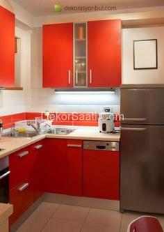 Modern Decoration Interior Design Kitchen With White Wall Fitted Wardrobes Orange Cabinets Lands And Gray Refrigerator Sink Beige