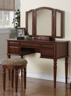 "Vanity Set with 3 Fold Mirror, Stool and Drawers in Dark Oak Finish. 3 Fold mirror vanity set. Dimension: 43"" x 19"" x 54""H. Set comes with 1 chair and 1 table. Dark oak finish. Assembly is required."