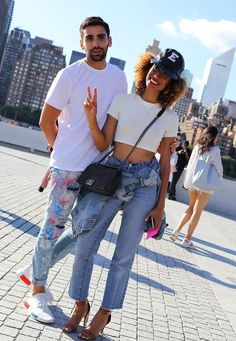 Phillip Picardi and Elaine Welteroth with a Chanel bag. On the street at New York Fashion Week. Photographed by Phil Oh.