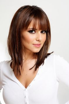 Cheryl Cole Lookbook: Cheryl Cole wearing Medium Straight Cut with Bangs (9 of 14). This is a classic straight cut, at medium length with bangs.