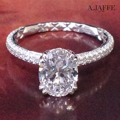 Style ME1842Q A.JAFFE Quilted pavé oval diamond engagement ring.