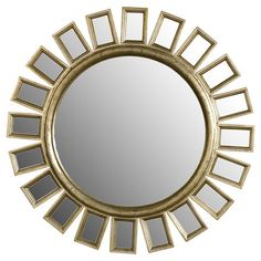 Sunburst wall mirror with a distressed wood frame. Product: Mirror    Construction Material: Wood and mirrored glass