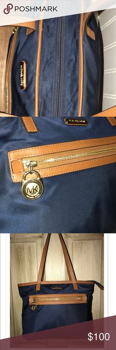 Michael Kors Purse. Beautiful MK Purse. Has a small pen stain inside on the bottom lining.Shows minor wear on shoulder straps. The purse is still in excellent shape other than what is pictured and mentioned in the description.. Dark Navy Blue trimmed in the traditional MK brown. No Trades. Please ask any questions you have BEFORE purchasing. I try to be honest about my listings. So please ask ???'s first. Thanks for stopping. Michael Kors Bags Shoulder Bags