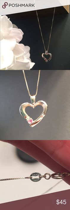 JB Robinson Heart Necklace Sweet heart shaped necklace on a 14k white gold box chain. Accented with two small stones. This was given as a gift; not sure if they are both sapphires, or one sapphire and one diamond? Selling because I simply don't wear it anymore. JB Robinson Jewelry Necklaces