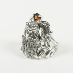 A very cool Sterling Silver Egyptian style scarab ring covered with tiny marcasite stones and a garnet at the mouth. The Scarab beetle was considered as the symbol of the Sun God Re and resurrection of eternal life $198