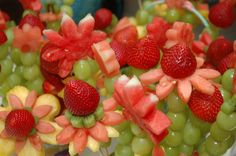 table centerpieces made with carved fruits | Baby Shower Food Ideas: Fruity Flowers, Savory Salads and Panini