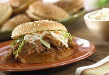 Looking to feed a hungry crowd?  These irresistible sandwiches feature slowly simmered pork in a sweet and spicy sauce...plus, everyone can serve themselves, so it′s easy on you.