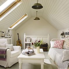 neat attic living room: love the white wooden ceiling and the windows. via House to home by abbyy
