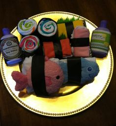 Satisfied a mommy-to-be's sushi craving with this fun baby shower gift. Made with socks, onesies, washcloths and bath sponges. Had so much fun putting this together!!