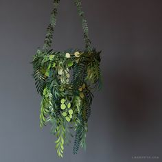 DIY Paper Greenery Chandelier from Lia Griffith.