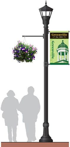 GBC light pole photo with banner and hanging planter