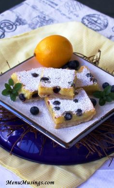 Blueberry Lemon Bars - These dainty Meyer lemon bars are made extra special with the addition of fresh blueberries and a toasted coconut shortbread cookie crust!