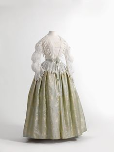 Matinee blouse and skirt, 1850-55 From the Mode Museum via Wikimedia Commons. Never seen anything of the 1860s era worn this way.