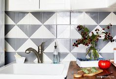 DIY Painted Tile Backsplash: Revamp your kitchen with this easy project tutorial.