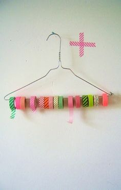 DIY Tape & Ribbon Holder Another alternative use for those wire hangers! Cut one end with wire cutters and loop them with pliers. Now you can open it up to easily store ribbon and washi tape. Washi Tape Storage, Ribbon Storage, Washi Tape Crafts, Washi Tapes, Diy Ribbon, Craft Room Storage, Craft Organization, Storage Ideas, Ribbon Organization