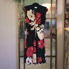 Jones Studio - Floral Dress Floral dress with light shoulder pads (can be removed if you please). Worn only a few times. EUC. Size 12. Jones Studio  Dresses Midi