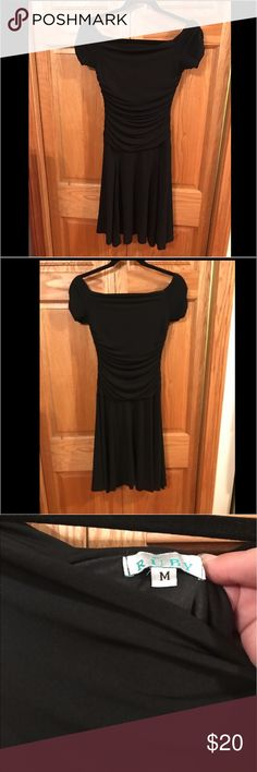 Black Off shoulder dress with ruching RUBY black off shoulder dress with ruched top.  Stretchy material.  Excellent condition.  Accessories not included. Ruby Dresses