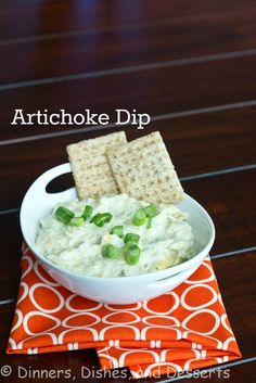Artichoke Dip From Cooking Light 2 cloves garlic 1 green onion, chopped ⅓ cup Parmesan cheese ⅓ cup light mayonnaise ¼ cup reduced fat cream cheese 1 Tbls fresh lemon juice ¼ tsp crushed red pepper 12 oz artichoke hearts