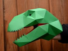 DIY t-rex dinosaur hand puppet from paper. Craft pattern shows you how to make your own pint-sized Jurassic carnivore!