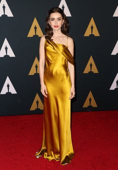 """Lily Collins wore an #AmandaWakeley """"Oleta"""" chartreuse silk gown to the 2016 AMPAS' #GovernorsAwards. The Fashion Court (@TheFashionCourt) 