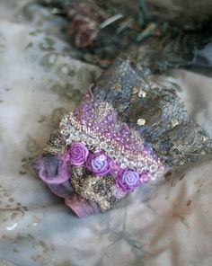 frost in May , tribal influenced romantic wrist wrap from antique lace and nuno felt