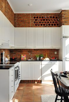 clay, wine racks, floor, wine holders, kitchen, exposed brick, wine bottles, place, white cabinets