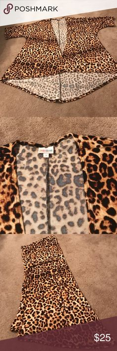 Animal print LulaRoe Lindsay Super cute animal print LulaRoe Lindsay! Worn only 2-3 time. Perfect for spicing up an outfit or little black dress. Wears a little big, but is super adorable if you belt it for a more form fitting look. Excellent used condition. LuLaRoe Sweaters Cardigans