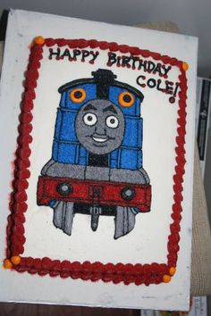 Full buttercream cake. Hand drawn Thomas the train.