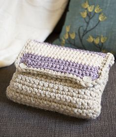 "A cute crocheted case/pouch/clutch that works up quickly using only single crochets. What makes this pattern unique is the yarn used to create it. I used Loops & Threads ""Phat"" yarn and two types of bulky acrylic yarn to add colour. Only basic construction is required. Use it as a makeup bag, a crochet hook case or to store a notebook and pen. Great for beginner crocheters."