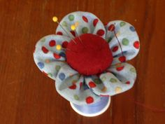 Golf tee pincushion to fit in a spool of thread