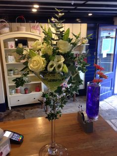 Our beautiful martini vases with cream flower arrangement.