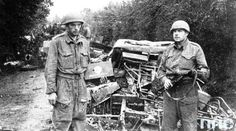 Soldiers of the 1st Armoured Division against the destroyed German equipment (Battle of Falaise).