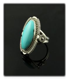 Checkout the stellar natural Sleeping Beauty Turquoise cabochon in this handmade Sterling Silver ring by Navajo Jewelry artisan Craig Cadman.  This top gem grade gemstones has not been treated, dyed, or enhanced with the Zachary Treatment.