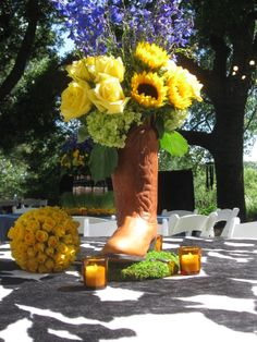 Cowboy Boot Centerpiece with the yellow rose of Texas. Cowboy Boot Centerpieces, I Do Bbq, Yellow Wedding Flowers, Western Parties, Cowgirl Party, Personalized Wedding Favors, Wedding Decorations, Wedding Ideas, Wedding Pictures